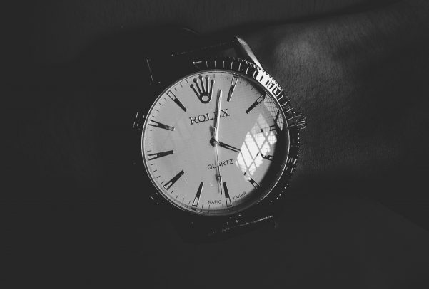 Rolex watch on a wrist in black and white
