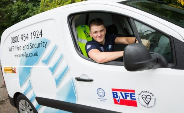 WFP Engineer in Van with BAFE third party accreditation sticker visible