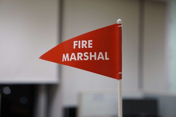 Red flag with 'fire marshal' written on it