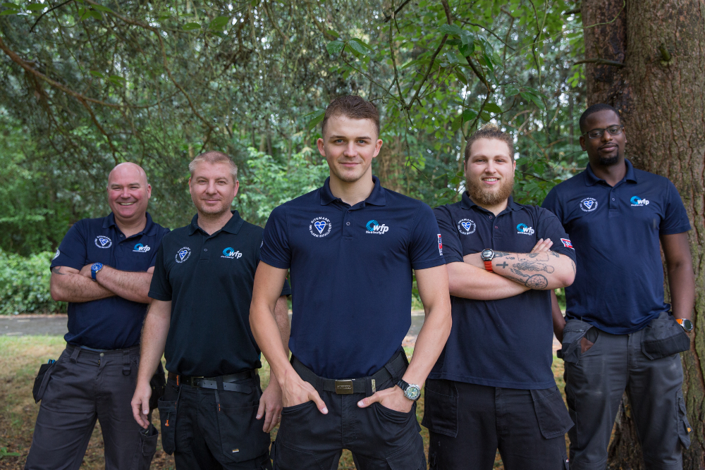 WFP Engineers wearing uniform smiling at camera